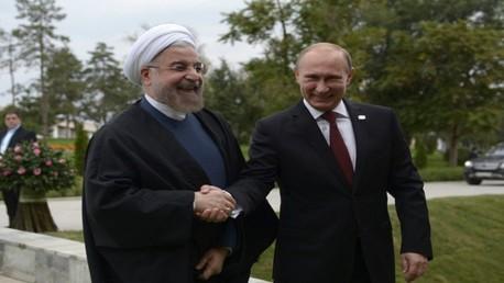 فلاديمير بوتين وحسن روحاني - صورة من أحد لقاءاتهما السابقة