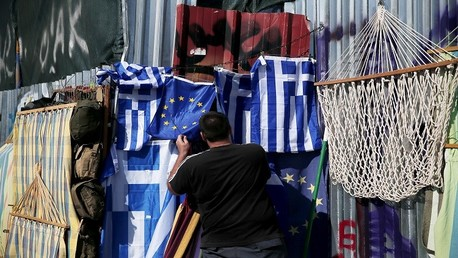 قادة اليورو يتوصلون إلى اتفاق ينقذ اليونان