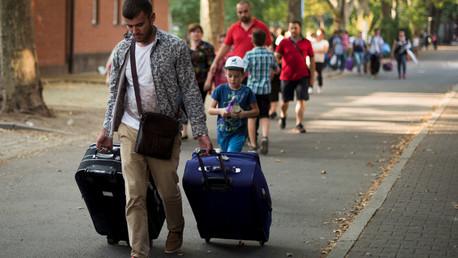 مهاجرون واصلون إلى ألمانيا بعد رحلة لجوء شاقة