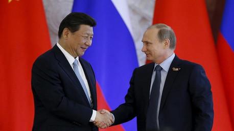 الرئيس الروسي فلاديمير بوتين ونظيره الصيني شي جين بينغ