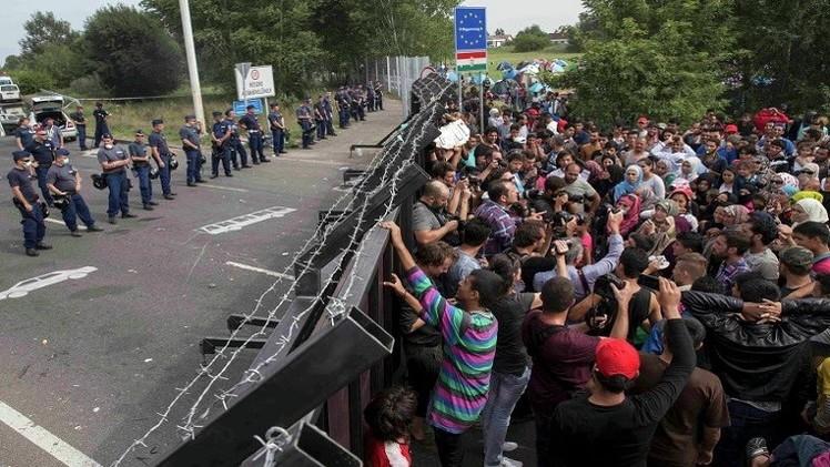 اللاجئون وجيش الاحتياط الهنغاري وجها لوجه (فيديو)