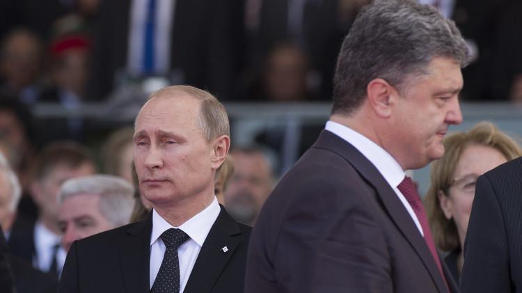المصافحة بين بوروشينكو وبوتين خط أحمر (فيديو)