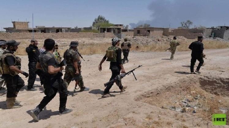قوات الحشد الشعبي تعلن تحرير مركز قضاء بيجي ومنطقة البو جواري .. صور