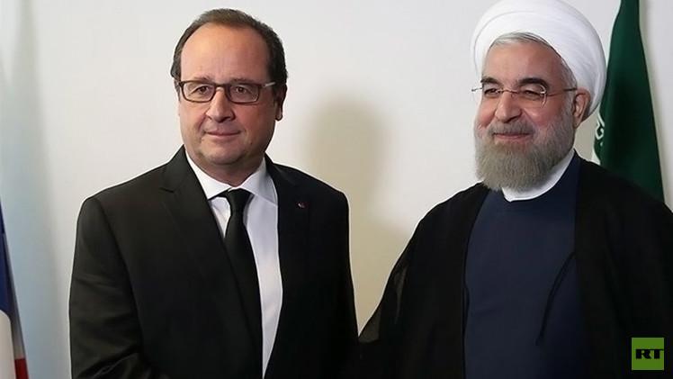 هولاند وروحاني يؤكدان أهمية المفاوضات الدولية لحل الأزمة السورية