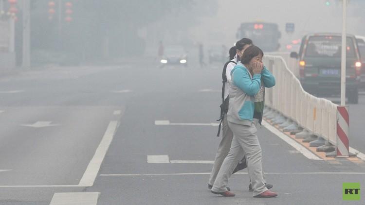 بكين ترفع حالة الإنذار بعد زوال الضباب الملوث