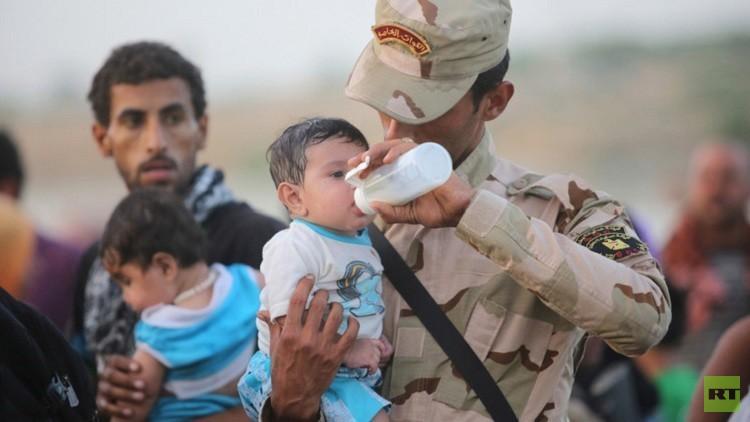 عراقية تضع مولودها وسط العبوات في الأنبار