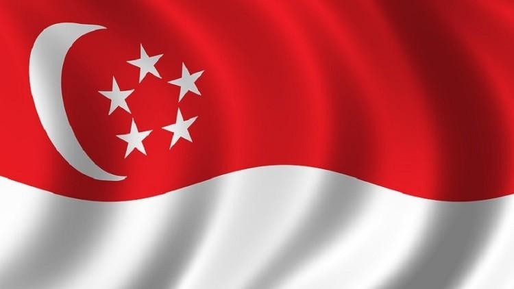 دبلوماسي إسرائيلي يستخدم علم سنغافورة