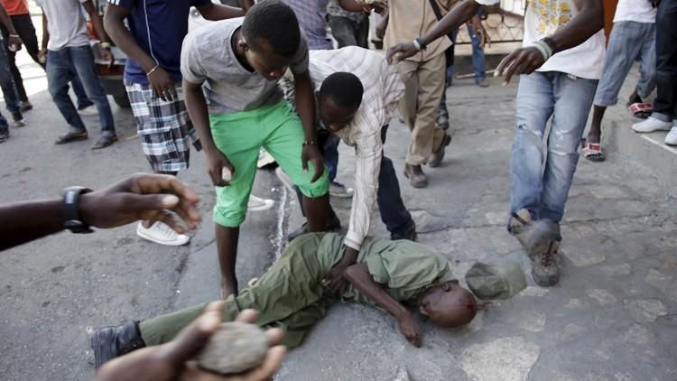 محتجون يرجمون عسكريا حتى الموت في هايتي