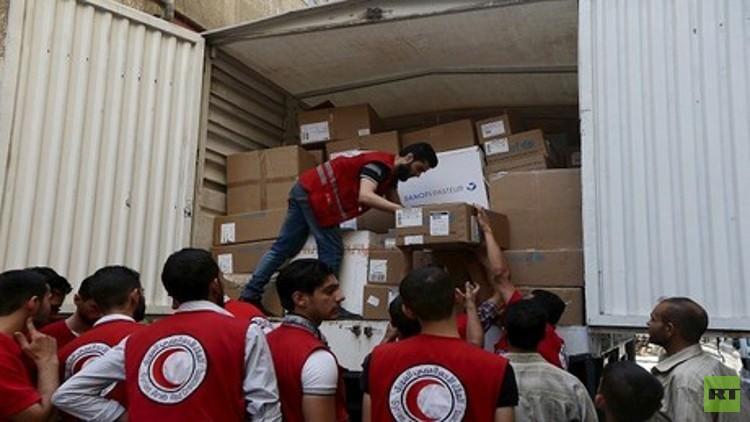 الصليب الأحمر: وصول مساعدات إلى بلدة محاصرة جنوب غرب دمشق