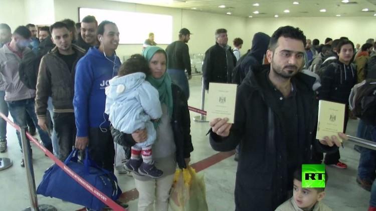 بالفيديو.. أكثر من مئة لاجئ عراقي يعودون من أوروبا