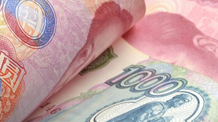 موسكو وبكين نحو تفعيل اَلية مبادلة العملات بينهما