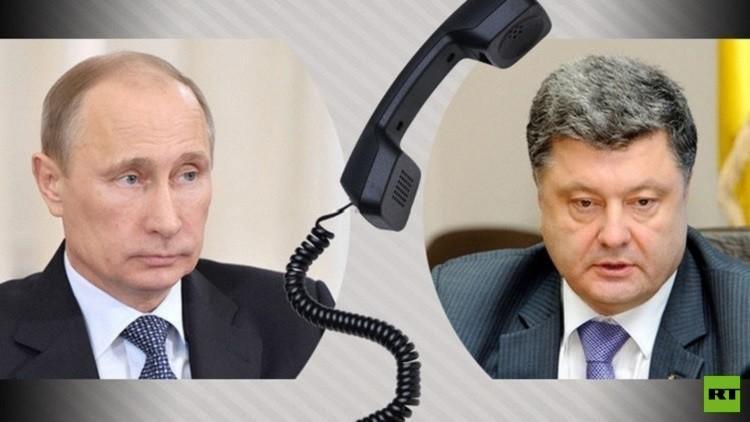 بوتين وبوروشينكو يبحثان الوضع في
