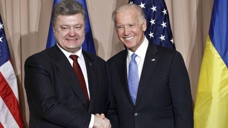 بايدن يعد بوروشينكو بدعم مالي بمليار دولار