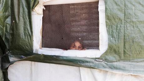 لاجئة سورية في أحد مخيمات اللجوء بلبنان