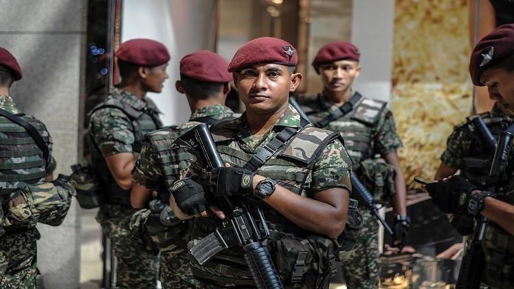 ماليزيا وإحباط هجوما بقنبلة كان يستهدف ضباط كبار في الشرطة وإعتقال 14شخص coobra.net