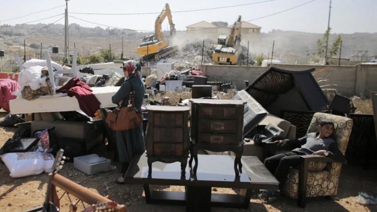 اسرائيل تهدم 12 منزلا فلسطينيا شمال القدس