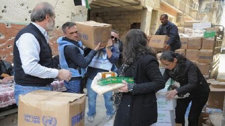 توزيع مساعدات الأونروا في مخيم اليرموك (صورة أرشيفية)