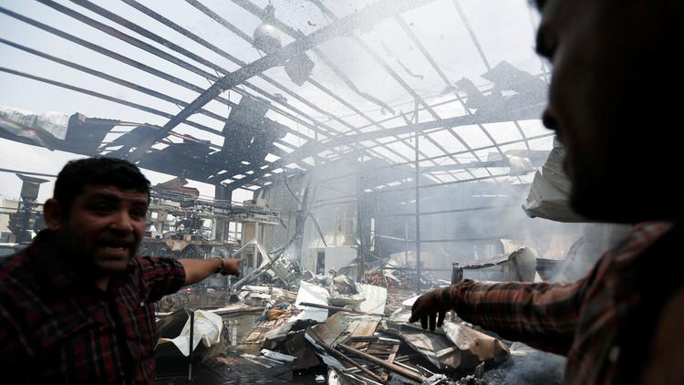 مقتل 14 عاملا بقصف للتحالف العربي على صنعاء (صور)