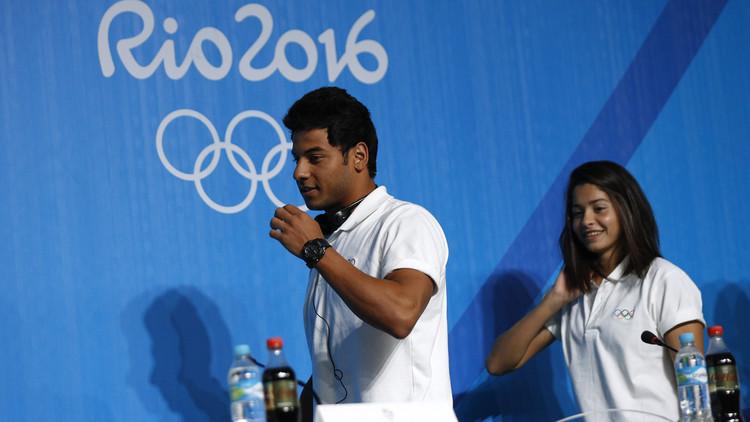 سباح سوري حزين لعدم تمكنه من المشاركة في افتتاح الأولمبياد تحت علم بلاده