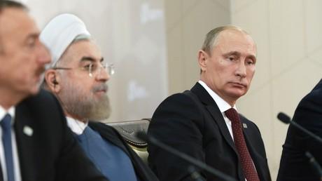 فلاديمير بوتين وحسن روحاني وإلهام علييف