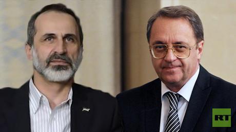 نائب وزير الخارجية الروسي ميخائيل بوغدانوف والمعارض السوري أحمد معاذ الخطيب
