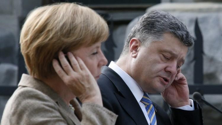 ميركل تدعو بوروشينكو إلى القيام بـ