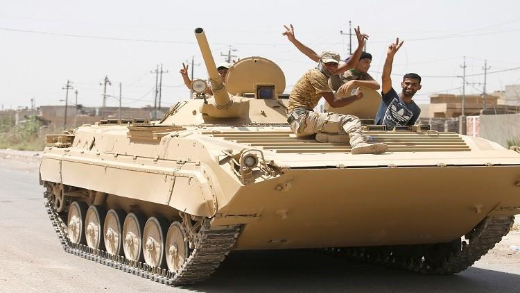 القوات العراقية تحاصر المجمع الحكومي في الشرقاط