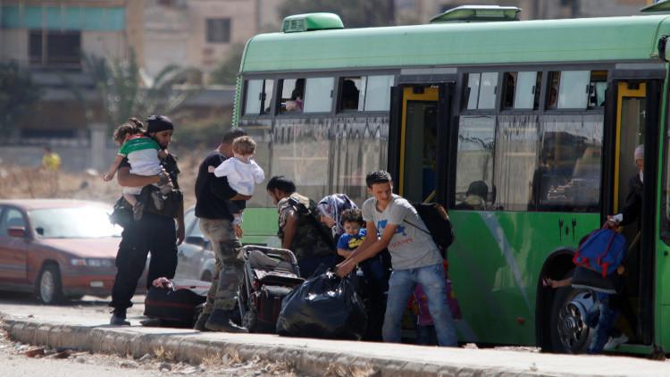 خروج دفعة ثالثة من مسلحي حي الوعر بحمص