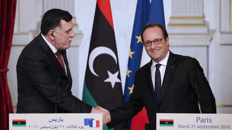 هولاند يؤكد للسراج دعم باريس لحكومة الوفاق الوطني