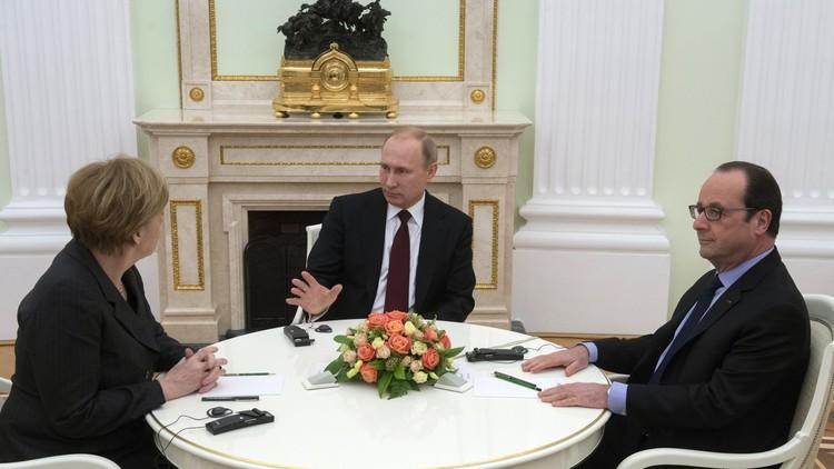 بوتين يبحث هاتفيا مع ميركل وهولاند أزمتي سوريا وأوكرانيا