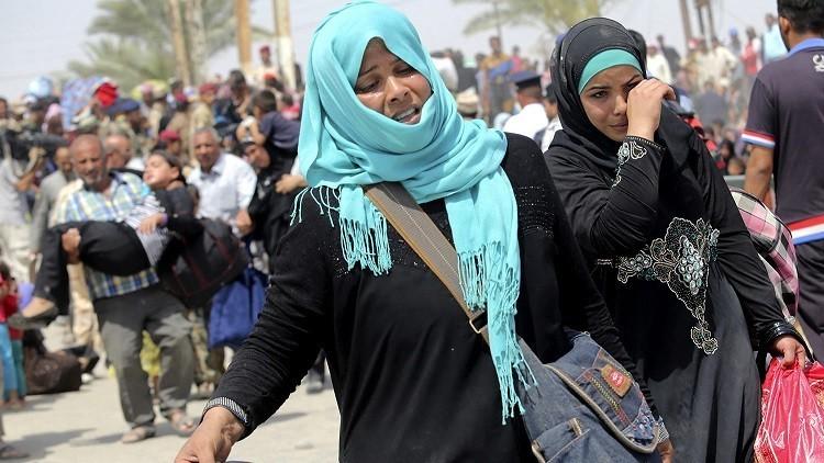 سكان الموصل يفرون إلى الأكراد السوريين