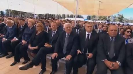 جدل فلسطيني حول مشاركة عباس بتشييع بيريس