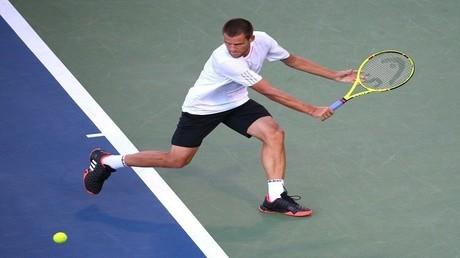 لاعب التنس الروسي ميخائيل يوجني