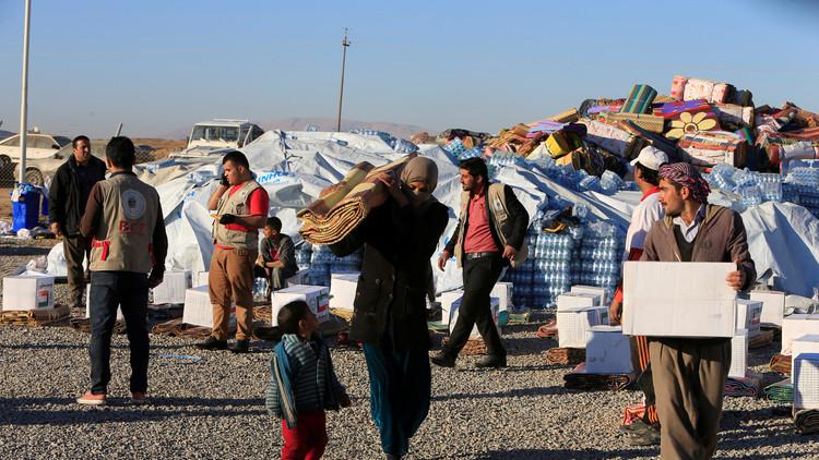 مقتل 11 مدنيا بينهم عمال إغاثة بهجومين في الموصل