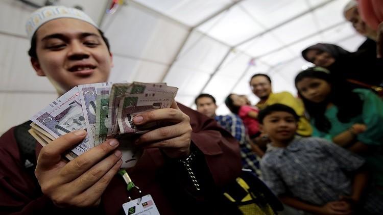 الرياض تطلق العملتين الورقية والمعدنية للتداول