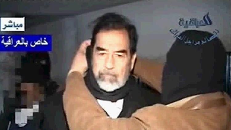 متى تم التوقيع على مذكرة إعدام صدام حسين؟