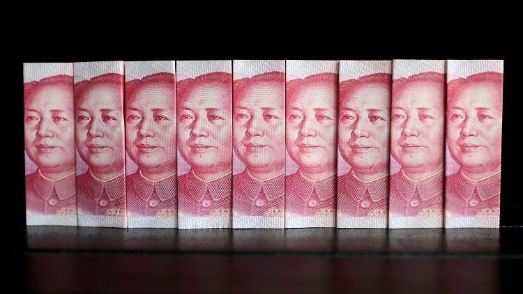الصين تخفض احتياطات النقد الأجنبي لدعم اليوان