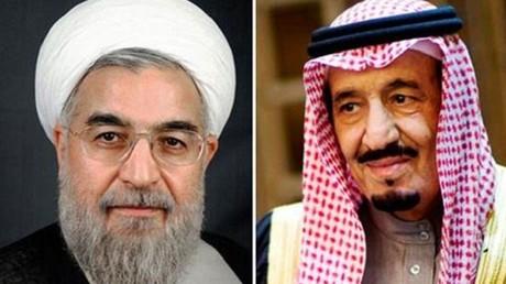 العاهل السعودي والرئيس الإيراني