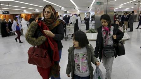 عودة عراقيين من فنلندا