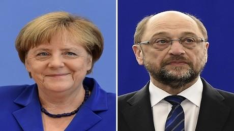 المستشارة الألمانية أنغيلا ميركل والمرشح الألماني عن الحزب الديمقراطي الاشتراكي مارتن شولتز