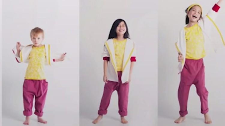 مصممو أزياء يفصلون ملابس للأطفال قابلة للنمو معهم