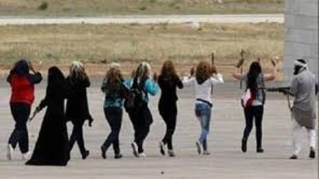 """نساء في قبضة """"داعش"""""""