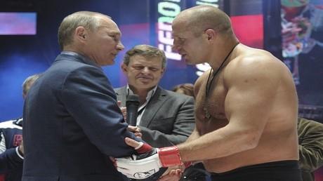 فيودور يميليانينكو مع الرئيس الروسي فلاديمير بوتين