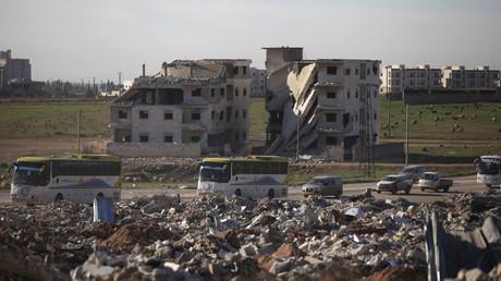 إجلاء مسلحي المعارضة وأفراد عائلاتهم من حي الوعر في حمص