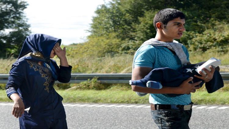 العفو الدولية تصطف إلى جانب اللاجئين السوريين بوجه السويد