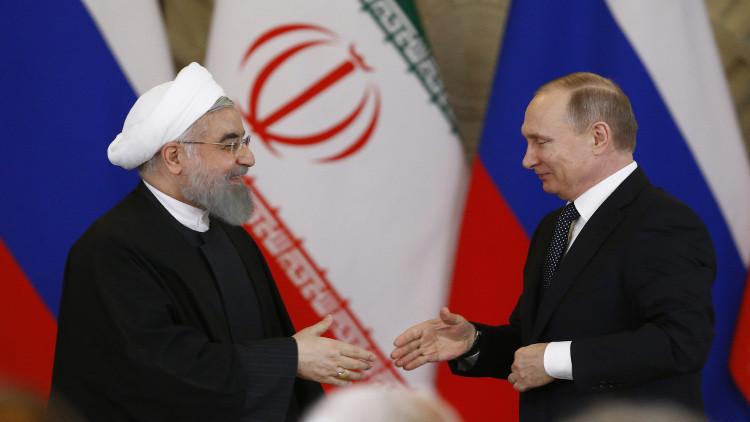 بوتين يهنئ روحاني بفوزه في الانتخابات الرئاسية