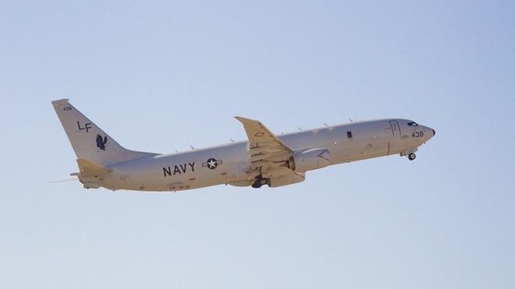 بشكل خطير للغاية مقاتلة صينية تقترب من طائرة استطلاع أمريكية