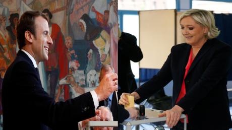 ماكرون ولوبان يدليان بصوتيهما في الانتخابات الفرنسية وسط حفاوة مؤيديهما