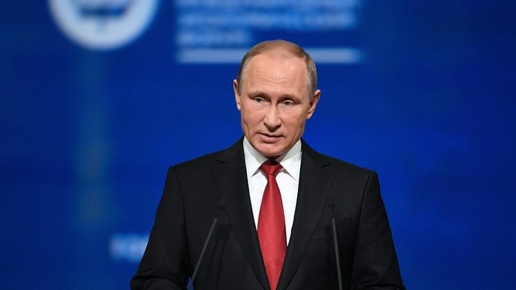 بوتين: روسيا لا تدافع عن الأسد