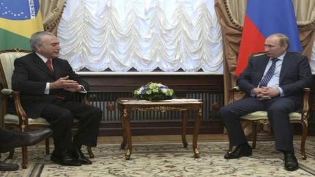 أرشيف - الرئيس الروسي فلاديمير بوتين ونظيره البرازيلي ميشال تامر